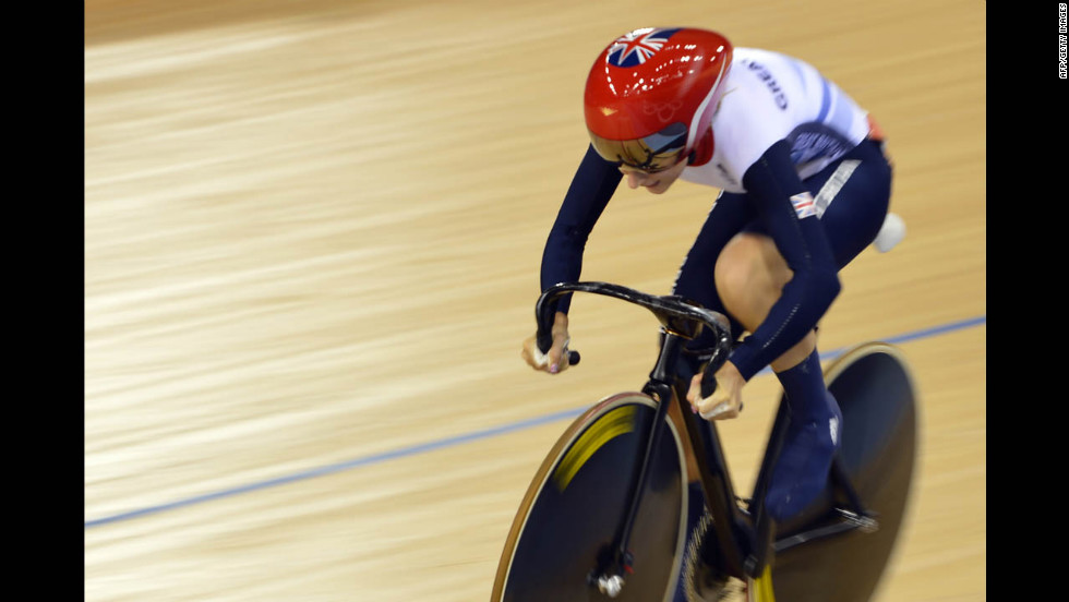 Britain's Laura Trott competes during the women's omnium flying lap 250-meter time trial cycling event at the Velodrome in London.