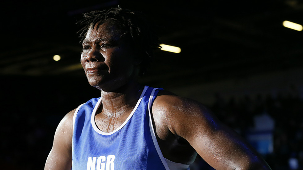 Nigeria's Edith Ogoke exits the ring following her points decision victory over Elena Vystropova of Azerbaijan in their women's Middleweight (75kg) boxing round of 16 on  August 5.