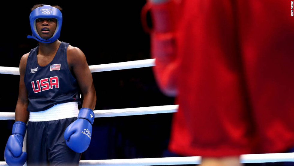 Claressa Shields, left, of the United States takes on Anna Laurell of Sweden during the women's middle 75-kilogram boxing quarterfinals.