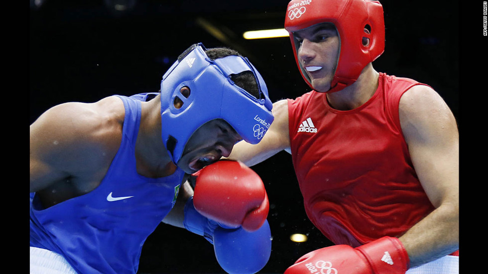 Esquiva Falcao Florentino of Brazil, left, takes a hit from Zoltan Harcsa of Hungary during the middleweight 75-kilogram boxing quarterfinals.