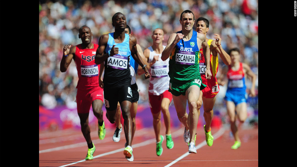 Nijel Amos, left, of Botswana and Fabiano Pecanha, right, of Brazil lead the field in the men's 800-meter heat Monday.