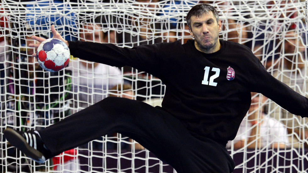 Hungarian goalkeeper Nandor Fazekas tries to block a shot from a Serbian player during the men's preliminary Group B handball match at the Copper Box hall in London.