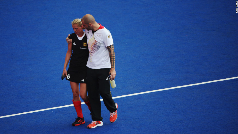 Fanny Rinne of Germany is consoled as she walks off the field after the women's field hockey match with New Zealand ended in a draw.