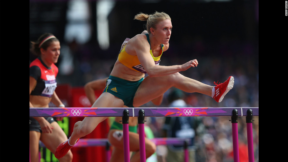 Sally Pearson of Australia competes in the women's 100-meter hurdles heat.