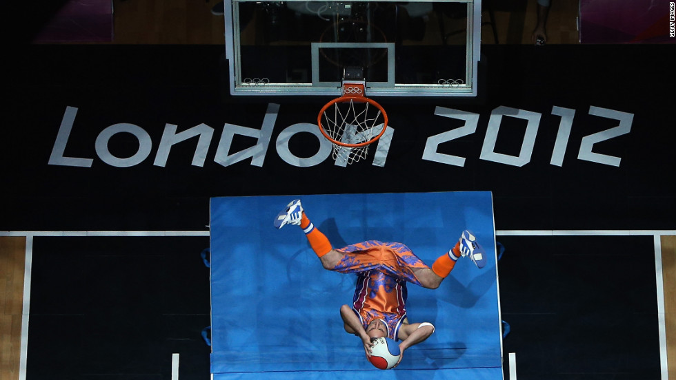 A performer dunks the ball during the halftime entertainment of the Russia and Australia men's basketball game.