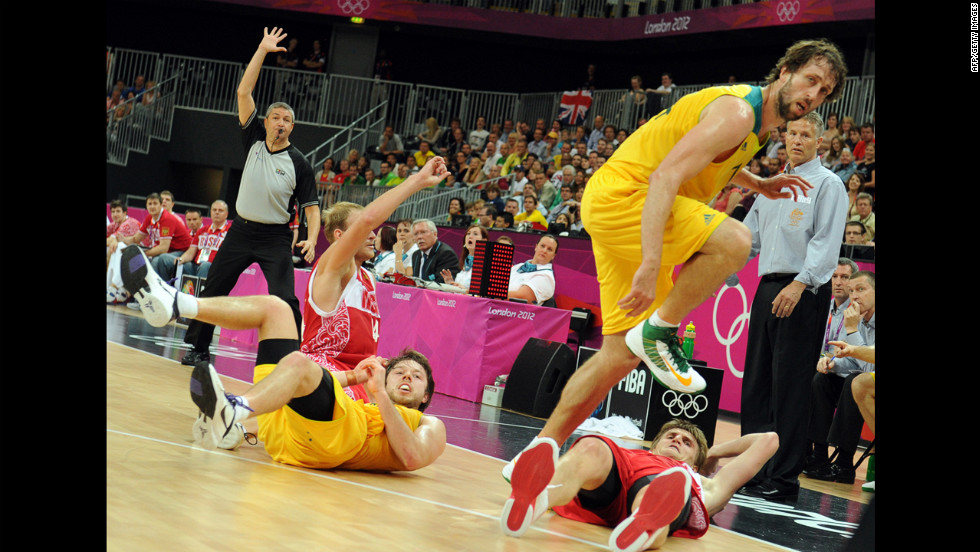 "Australian, in yellow, and Russian players collide during the men's basketball preliminary round match. Check out photos of <a href=""http://www.cnn.com/2012/08/07/worldsport/gallery/olympics-day-eleven/index.html"" target=""_blank"">Day 11 of the competition</a> from Tuesday, August 7."