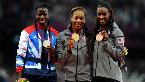 From left, silver medalist Christine Ohuruogu of Great Britain, gold medalist Richards-Ross and bronze medalist DeeDee Trotter of the United States show off their medals during Sunday