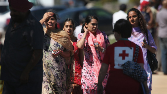 People gather outside a Sikh temple in Oak Creek, Wisconsin, where a gunman killed six people Sunday.