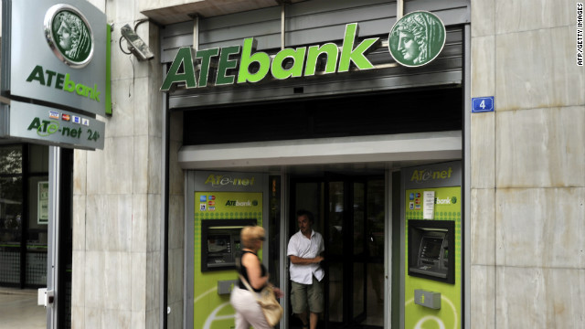 A man leaves an Agricultural Bank in central Athens on July 15, 2010.