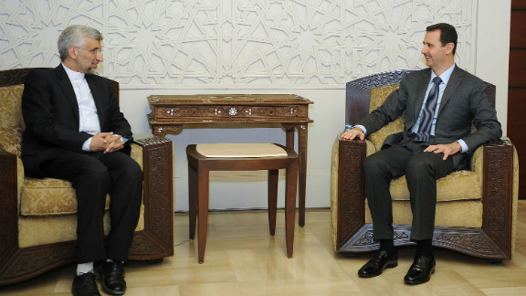 Syrian President Bashar al-Assad, right, meets with a top aide to Iran