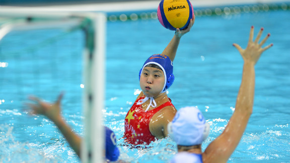 Chinese water polo player Sun Yujun prepares to shoot a goal against Italy during the women
