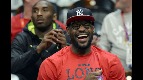 U.S. forward LeBron James, front, and guard Kobe Bryant attend the U.S. women