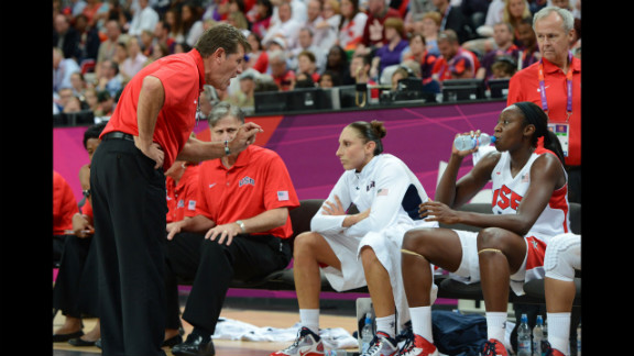 U.S. coach Geno Auriemma talks to his players during the women