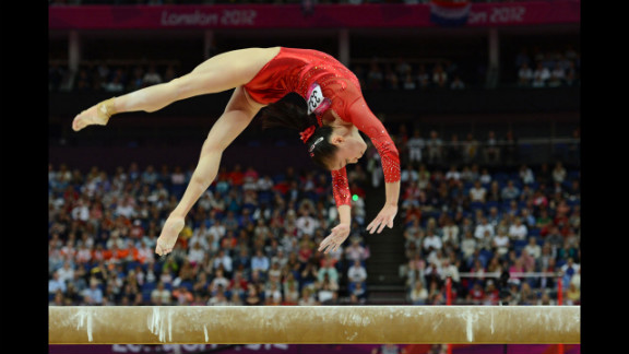 Chinese gymnast Sui Lu performs on the balance beam during the women