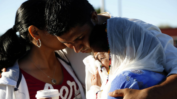 Amardeep Kaleka is consoled at the command center near the Sikh Temple of Wisconsin on Monday.