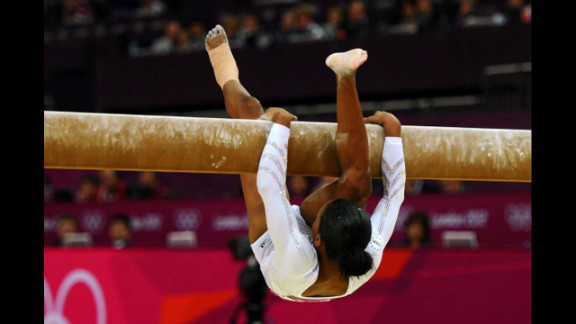 American gymnast Gabrielle Douglas falls off the beam during the women