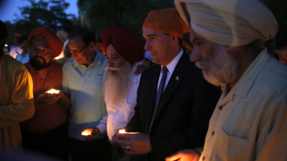 Wisconsin Gov. Scott Walker, along with members of the Sikh community, attends Monday