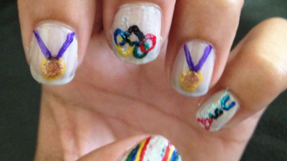"""""""I'd consider myself somewhat of a tomboy,"""" said Sonia Silva of San Diego. """"I thought it'd be cool to try to put a sporty spin on a girly hobby, and I decided to try Olympic themed nail art."""" The little gold medals are especially cute!"""