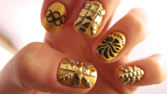 """Jenny Pasha of London created this studded manicure in support of Team GB. """"I have done Union flag nails many times in the past, but for the Olympics, everyone's goal is to go for a gold medal, so I decided to do an all gold set of nails,"""" she explained."""