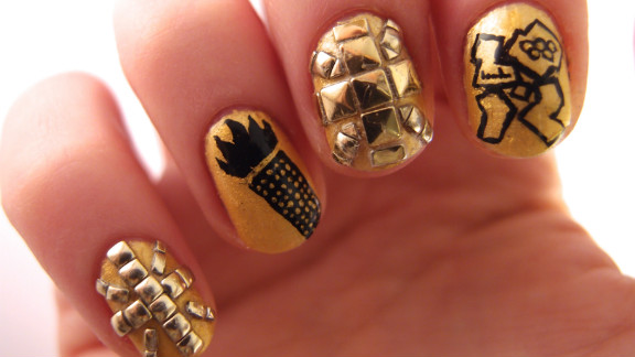 Pasha shows off the other half of her elaborate gold manicure. She says it took her about two hours to create the design.