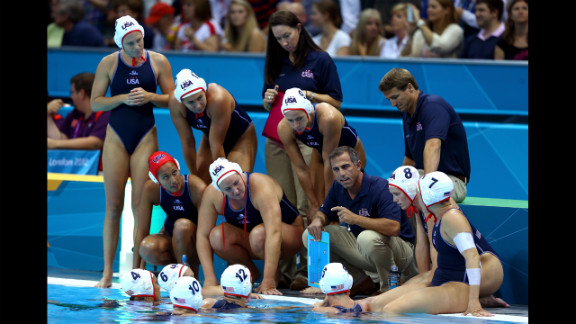 United States water polo coach Adam Krikorian talks with his players during the women