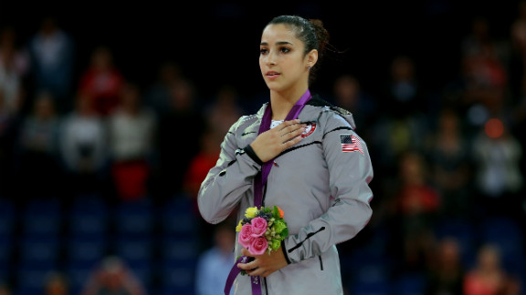 Gold medalist Alexandra Raisman poses on the podium during the medal ceremony for the women