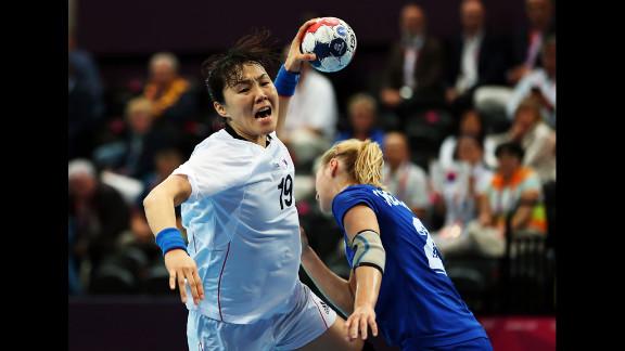 Im Jeong Choi, No. 19 of Korea, shoots over Olga Chernoivanenko, No. 29 of Russia, during the women