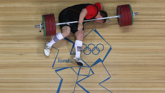 Matthias Steiner of Germany lies on the floor after failing to lift in the men
