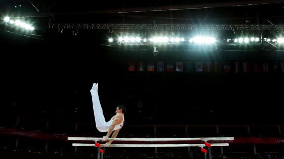 Hamilton Sabot of France competes on the parallel bars during the gymnastics men