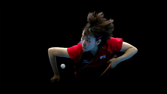 Kasumi Ishikawa of Japan competes against Ning Ding of China during the women