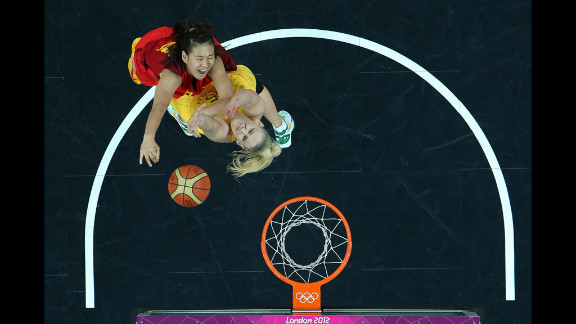 Song Gao, No.12 of China, shoots over Lauren Jackson, No. 15 of Australia, during the women