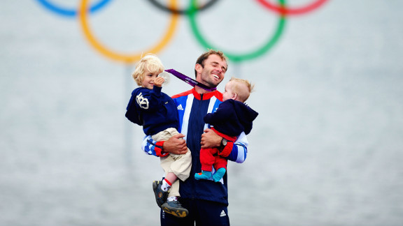 Silver medallist Nick Dempsey of Great Britain celebrates with his children Thomas-Flynn, left, and Oscar after the men