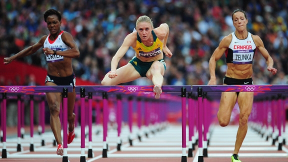 Sally Pearson of Australia leads Tiffany Porter of Great Britain and Jessica Zelinka of Canada in the women