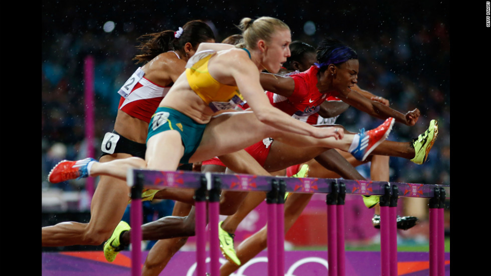 Sally Pearson of Australia leads Nevin Yanit of Turkey and Kellie Wells of the United States during the women's 100m hurdles final. She went on to win the race.