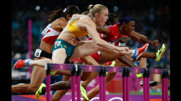 Sally Pearson of Australia leads Nevin Yanit of Turkey and Kellie Wells of the United States during the women