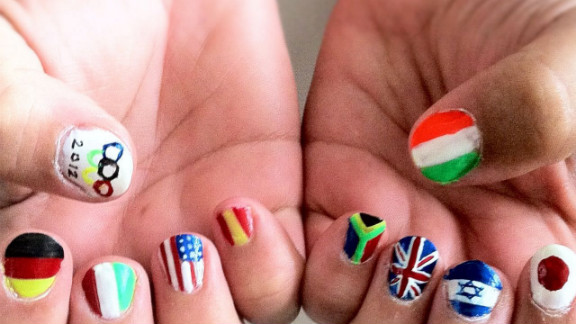 """Maria Maslin painted her mother's nails to reflect several of the countries competing in the Olympics this year. """"I tried to be diverse with the countries I picked in order to represent a large span of the world,"""" she explained. From left, the flags represented are Germany, Italy, United States, Spain, South Africa, Great Britain, Israel and Japan. On her thumbs are the Olympic flag and Ireland."""