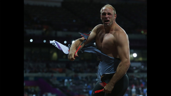 Robert Harting of Germany celebrates winning gold in the men