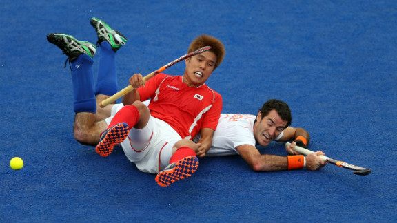 Hyo Sik You of South Korea falls on top of Marcel Balkestein of Netherlands during their men