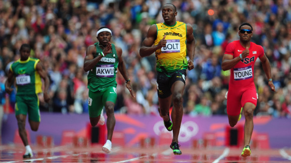 Usain Bolt of Jamaica leads Noah Akwu of Nigeria and Isiah Young of the United States in the men