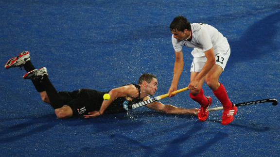 Tobias Hauke of Germany and Phillip Burrows of New Zealand challenge for the ball during the men