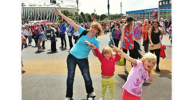 """Emma Allen from Farnborough, England and her two daughters strike a Bolt pose with her two daughters at the Olympic Park. """"My eldest is Olympics mad and loves this pose! I thought it would be great to do it in the Olympic Park. Of course in the evening Usain did his thing again!"""""""