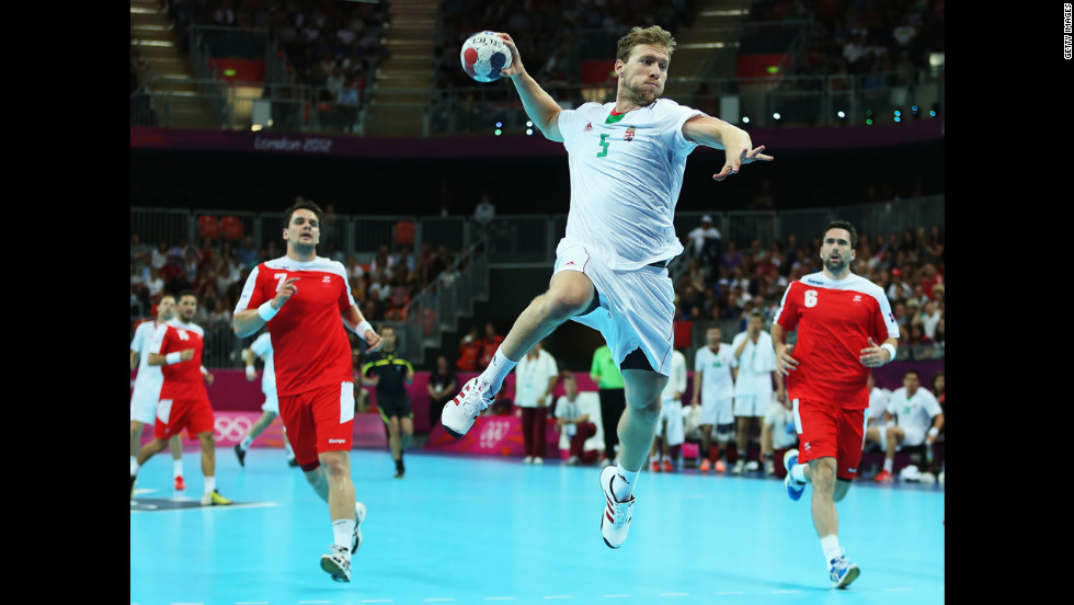 Hungary's Gabor Csaszar scores on a fast break during the men's handball quarterfinal match against Iceland.