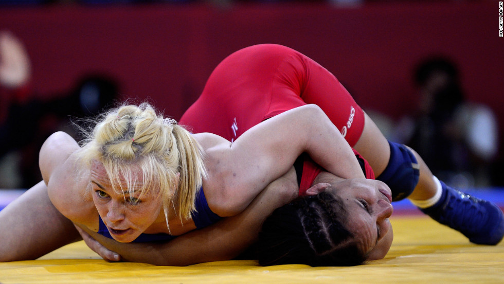 Ukraine's Irini Merleni, left, wrestles with Venezuela's Mayelis Yesenia Caripa Castillo during the women's 48-kilogram freestyle wrestling quarterfinal match.