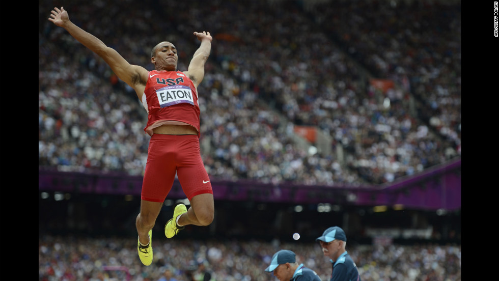 American Ashton Eaton competes in the men's decathlon long jump qualifications.