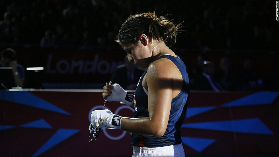 Marlen Esparza of the United States leaves the ring following her loss to Cancan Ren of China in the women's flyweight boxing semifinals.