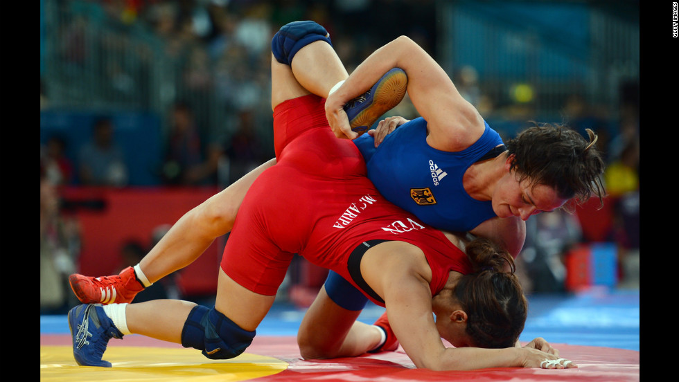 Germany's Alexandra Engelhardt, right, competes against Mayelis Yesenia Caripa Castillo of Venezuela in women's freestyle 63-kilogram wrestling.