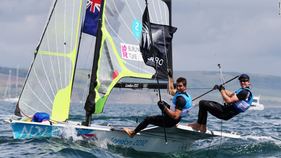 Blair Tuke, left, and Peter Burling of New Zealand celebrate winning silver in the men's 49er sailing event in Weymouth, England.