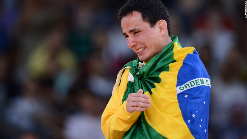 Brazil's bronze medalist Felipe Kitadai cries on the podium after the men's lightweight judo match.