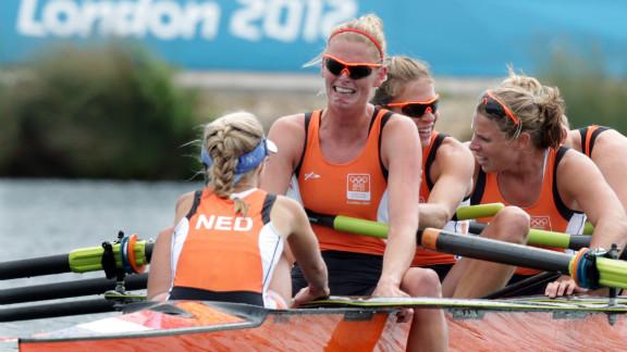 Annemiek de Haan of the Netherlands cries after her crew finished third in the women