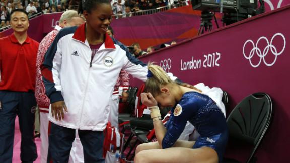 American gymnast Gabby Douglas, left, comforts Russia